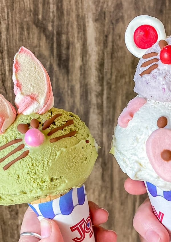 green ice cream cone in the shape of a bunny and white ice cream cone in the shape of a pig