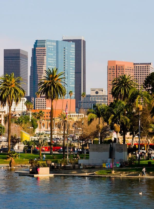 skyline of los angeles featuring a pond